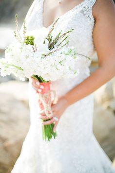 all white bouquet with pops of greenery http://www.weddingchicks.com/2014/02/10/serra-plaza-wedding-san-juan-capistrano-aga-jones-photography/