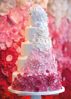 Pink ombre flowers make this wedding cake a standout