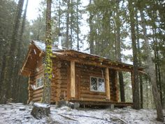 small cabin in the woods, just starting to snow again