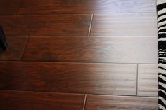 Wide Plank Laminate Flooring: Sams Club for $1.50/square foot. The hand scraping gives it a ton of character.  The commercial grade quality makes it almost indestructible.