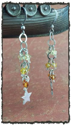 Star bright! Swarovski crystals cascade down .925 SS chain to a .925 SS star charm. Finished with SS ear wires these lovelies sure do shine!...