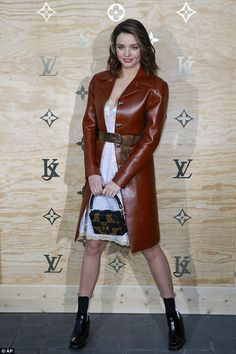 Dressed to impress: Miranda Kerr was looking her best when she attended the Louis Vuitton ...