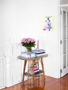 Halltable. Miranda Skoczek painting on wall. Photo -Toby Scott, production – Lucy Feagins / The Design Files.