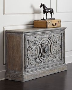 """Handcrafted cabinet. Made of hardwood solids. Distressed vintage-style finish. Two doors and one adjustable shelf. Ventilated for TV use. 60""""W x 18""""D x 38""""T. Imported. Boxed weight, approximately 258"""