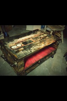 """My pallet coffee table. Has caster wheels, bottle opener attached on front and a metal handle on side. The top is a painted 68 GTO then epoxy sealed to give a """"glass finish"""".  Hope this one makes someone happy! :)"""