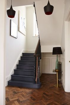 Dark blue painted wooden stairs and parquet floor painting wooden stairs, black painted stairs, Painted Staircases, Interior, Hallway Inspiration, Staircase Design, Home Decor, House Interior, Herringbone Floor, Wooden Stairs, Painted Stairs