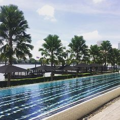 Enjoying this poolside view of the Chao Phraya during a sunny afternoon @thesiamhotel. Who's up for a swim? ~@lindsey_ueberroth #thePreferredLife #PHRtakeover