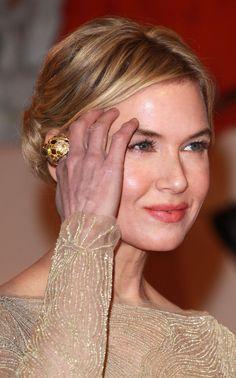 Renee Zellweger updo hair corall lips eyes ring hand