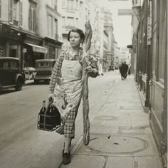 A Woman and her Baguette, Paris 1945; Photograph by Branson Decou