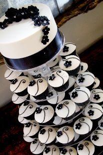 Black and Ivory Wedding Cupcake Tower. Definitely leaning towards cupcakes at my wedding. Pretty Cakes, Beautiful Cakes, Amazing Cakes, Cupcake Tower Wedding, Wedding Cakes With Cupcakes, White Cupcakes, Cupcake Towers, Elegant Cupcakes, Simple Cupcakes