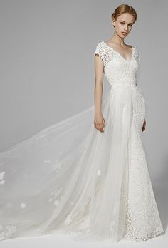 Peter Langner. Mermaid gown in lace with detachable overskirt in lace.