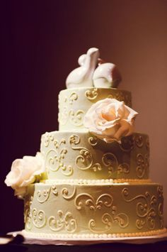 love birds topper on and a gorgeous three tiered cake.