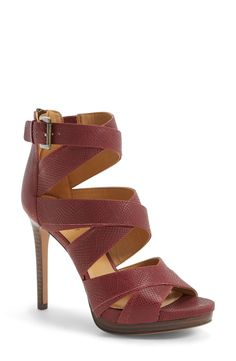 The fun crisscrossed style and a slim, flattering heel makes these flirty leather sandals just right for a night out on the town.