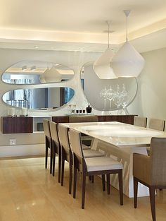Contemporary Dining Room by Roberta Devisate.