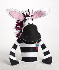 Use contrasting coloured felt and embroidery thread to create this super cute zebra hand puppet character.