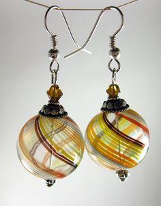 Swirly Globe Blown Glass Earrings. $33.75, via Etsy.