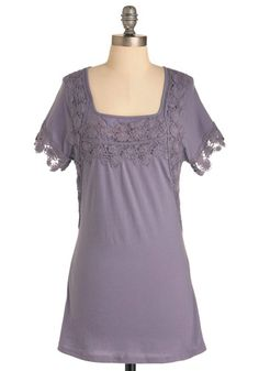 Pretty little top for spring/summer. Love the lacy edges on the sleeves!