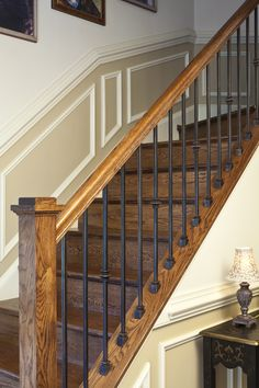 Custom fabricated wrought iron spindles with stained rail post, steps and risers