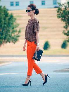 clutch with orange pants and brown top