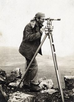 A surveyor uses a theodolite at a triangulation station. - 42-32918627 - Rights Managed - Stock Photo - Corbis