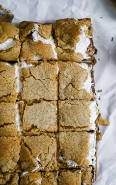 OMG S'mores Bars - Perfect for picnics, of July, parties and s'mores addicts. Layers of luscious graham cracker cookie dough, billowy marshmallow fluff and rich milk chocolate bar! Wooing you in? Damn you S'mores Bars! I can't quit you! Mini Desserts, Just Desserts, Summer Cookout Desserts, Fast And Easy Desserts, Camp Desserts, Sweet Desserts, Yummy Treats, Sweet Treats, Yummy Food