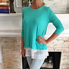 Gorgeous turquoise 3qtr sleeve lace detail top! Lightweight in a gorgeous summer color! This lovely blouse features a white lace scalloped front and split lace detail in back! Beautiful' Tops