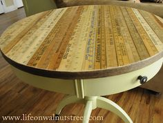 yard stick table...if I could get my hands on enough Perry's Hardware yard sticks, I would love. this!!!