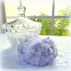Lavender Powder Puff . Soft lilac plush with white elasticized finger grip. Simple elegance and vintage charm. ~ Includes a complimentary Body Powder sample. Measures approx 4  inches across (10.2 cm) ; puff is gift boxed.Wash and care instructions included.  This is for the Powder Puff only. Photo props not included. Powder puffs add a touch of pampered luxury to your lovely vanity area. Dust yourself with your most refreshing body powder. Even if you dont use body powder, these feminine…