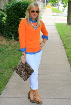 Cute outfit - white jeans, chambray shirt under an orange sweater with a cheetah print clutch...might do a different shoe though.