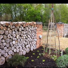 Log wall Garden Buildings, Garden Structures, Yard Crashers, Wind Break, Deer Fence, Log Wall, Living Fence, Gnome House, Fence Landscaping