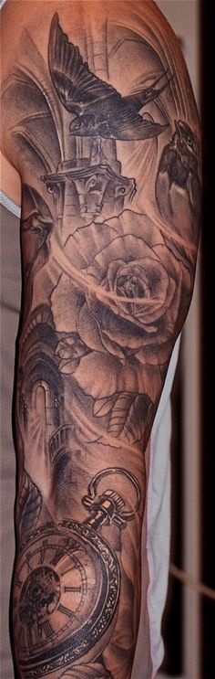 inspiring Rose, bird, clock black and grey tattoo on sleeve. Very smooth shading and looks gorgeous.