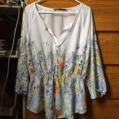 floral ivanka trump peasant top beautiful floral spring top with tie front and gathered waist very light material Ivanka Trump Tops Blouses