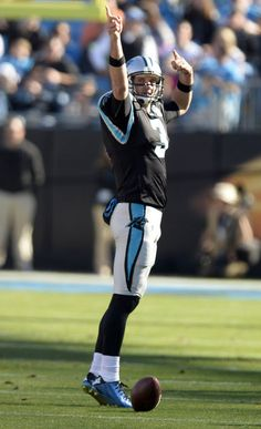 Carolina Panthers' Derek Anderson (3) signals a first down, after running for it, against the Tampa Bay Buccaneers in the first half at Bank of America Stadium on Sunday, December 14, 2014. Tampa Bay led, 10-9, at halftime.
