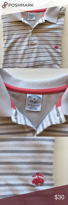 Brooks Brothers 100% cotton Unisex Polo Brooks Brothers 100% cotton Unisex Performance Polo in Excellent Condition, no stains etc. the color White with Pink and gray stripes. Size M Slim Fit Brooks Brothers Tops Button Down Shirts