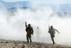 Royal Marines with 40 Commando Group run through a smokescreen across the barren landscape of the Mojave Desert in California, USA during Ex...