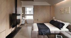 televisor grande en el dormitorio al estilo minimalista