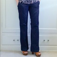 """Express Trouser Jeans NO TRADES. OFFERS WELCOME. PLEASE USE THE OFFER BUTTON. I DO NOT NEGOTIATE PRICE IN THE COMMENTS. Trouser-style jeans from Express. Zipper, button and tab closure. Slit pockets in front. Two pockets in back. Dark wash. Inseam is 31"""". 16"""" across at waist laying flat. Rise is 7.5"""". Flare is 10"""" across laying flat. 64% cotton, 36% Lycra elasterell. In excellent pre-loved condition. Express Jeans Flare & Wide Leg"""