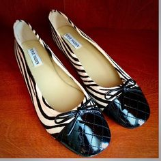 NWOT Steve Madden D' Orsay Zebra Flats 9.5M Brand new, calf skin leather with a black and white zebra print. Quilted patented black toe caps runs a bit narrow. Size 9.5 medium. ***Please note the white shine on the black toe caps are reflections from the light, NOT scuffs or discolorations!** Steve Madden Shoes Flats & Loafers