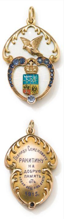 *A FABERGÉ JEWELED GOLD AND GUILLOCHÉ ENAMEL COMMEMORATIVE JETON, WORKMASTER EDUARD SCHRAMM, ST. PETERSBURG, 1915