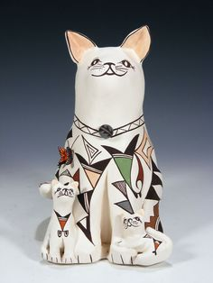 Judy Lewis is a full blooded Native American Indian from the Pueblo of Acoma and she was born in 1966. She has been making pottery since 1986. Judy was inspired