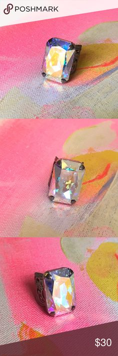Giant super sparkly ring This ring demands attention every time you wear it. Large iridescent stone creates tons of sparkle and light play. Adjustable. Jewelry Rings