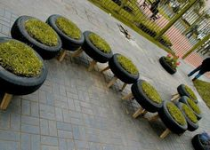 """Tire stools....I'm thinking this would work good using 4 or 5"""" diameter chunks of tree limbs as legs and filling them with herbs for a garden that I wouldn't need to bed down so far to tend and less weeding!"""