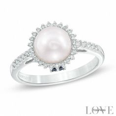 Take her breath away with this dramatic pearl and diamond fashion ring from the Vera Wang Love Collection. Crafted in cool 14K white gold, this stunning style showcases a luminous 7.5-8.0mm cultured Akoya pearl center stone wrapped in the sparkling embrace of a diamond sunburst frame. Additional diamonds line the ring's slender shank. Set into the bezel are two princess-cut blue sapphires, the signature of the collection and a symbol of faithfulness and everlasting love. Radiant with 0.14...