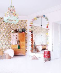 i love the giant mirror and vintage wallpaper