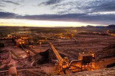 There are 400 natural resources projects taking place in Australia worth about 450 billion dollars. This pic - Iron Ore mining, Pilbara Region, Western Australia.