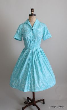 a cheery, classic early 1960s shirtwaist dress.  https://www.etsy.com/listing/109405245/vintage-1960s-dress-50s-60s-paisley