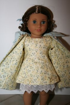 This is the new MDH pattern done in a soft yellow floral with a woven blue coat and purse