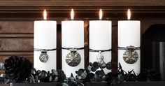 Striking black and white Advent wreath using medallions instead of number tags.