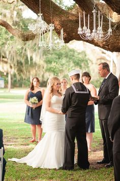 Chandeliers hung from giant oak | Coral & Navy Vintage Inspired Nautical Wedding At The Ribault Club Jacksonville Florida | Photograph by Britney Kay Photography   http://storyboardwedding.com/vintage-nautical-wedding-ribault-club-jacksonville-florida