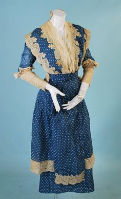Late Edwardian/WWI Polka Dot Silk Dress with Lace, circa 1909/1915 via eBay | Measurements: 34-28-n/a The overall silhouette (flared overskirt over slimmer underskirt, ankle length, squared hem detail on overskirt) indicate that this dress is styled for 1915. The bodice, however, is earlier in style and appears to have been altered to update it. The lace applique, remnants of a high collar at the neck, waist level, and sleeves are about 5 years older in design, around 1909-10.